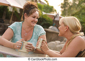 Girlfriend Conversation - Two Girlfriends Enjoy A Casual ...