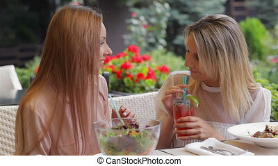 Girlfriend drink cocktails and gossiping