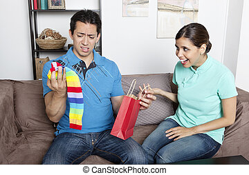 Girlfriend Gives Boyfriend Gift - Latin American couple...