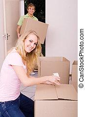 girlfriend helping boyfriend move in