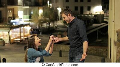 Girlfriend proposing marriage to her boyfriend