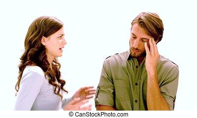 Girlfriend shouting at boyfriend as he rolls his eyes on...