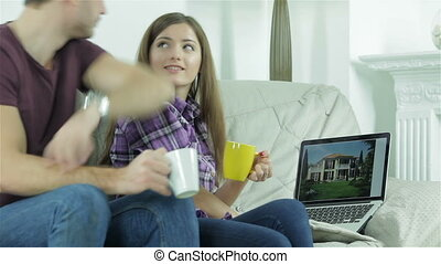 Girlfriend shows her boyfriend design a new building on the laptop
