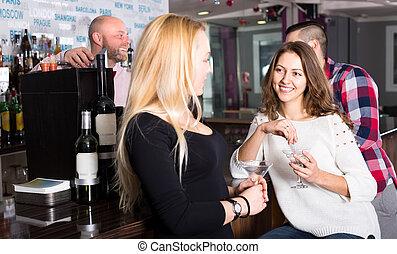 Girlfriends at the bar