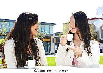 Girlfriends having coffee
