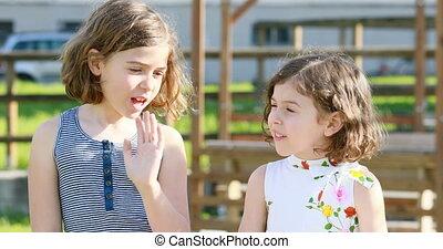 girlies simpering a gossip talk - two little girls talking ...