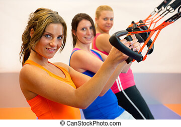 suspension training - Girls are doing suspension training in...