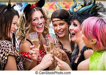 Girls at Carnival parade clinking glasses with champagne