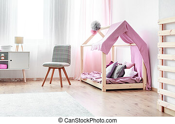 Girl's bed in bedroom interior