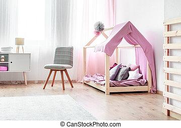 Girl's bed in bedroom interior