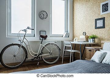 Girl's bike in contemporary bedroom