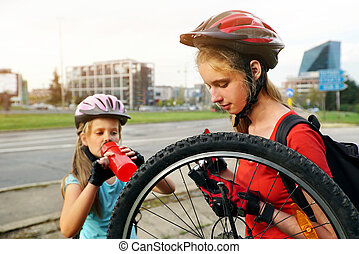 Girls children cycling Family pump up bicycle tire.