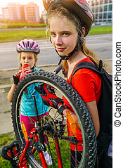 Girls children cycling Family pump up bicycle tire. - ...