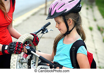 Girls children cycling Family pump up bicycle tire. - Bikes ...
