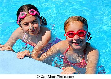 Girls children pool - Two girls having fun in a swimming...