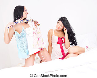girls choosing clothes - beautiful brunette girls choosing...