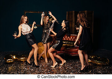 Girls dancing and drinking champagne at party