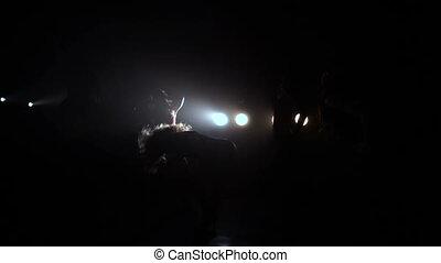 Girls dancing in black studio