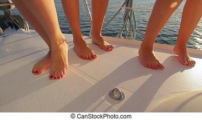 Girls dancing on board. Legs of girls close-up.