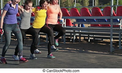 Girls do fitness exercise steps together