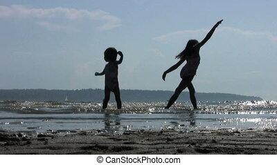 Girls Doing Ballet In The Beach