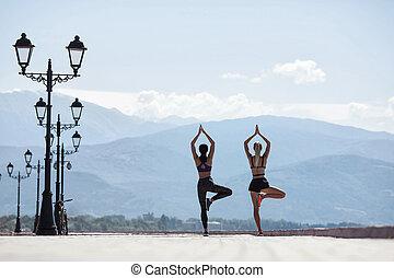 Girls doing yoga in the morning