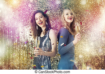 Girls drink sparkling wine to celebrate the new year