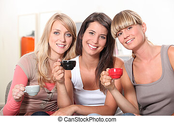 Girls drinking a cup of coffee