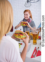 Girls eating burgers