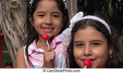 Girls Eating Lollipop