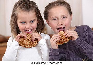 Girls eating pancakes