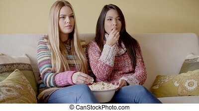 Girls Eating Popcorn While Watching Movie at Home