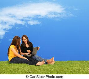 Girls Enjoying Laptop Outdoor