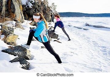 Girls exercising outdoors