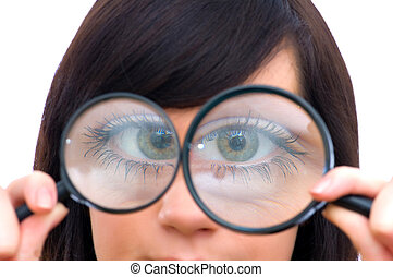 Girl\'s eye magnified through magnified glass on white