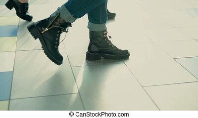 Girls Fashionable Shoes - Low shot of two girls walking in...