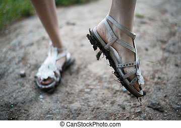girls feet in dirty sandals - girl shows dirt on his sandals
