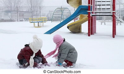 Girls fight with snow in park