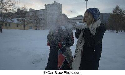 Girls fool around in the street in winter