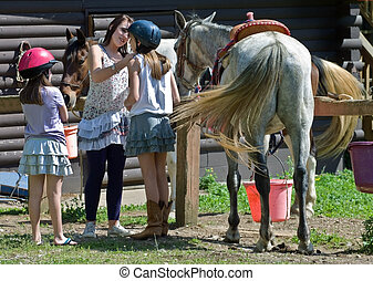 Girls Getting Ready to Ride
