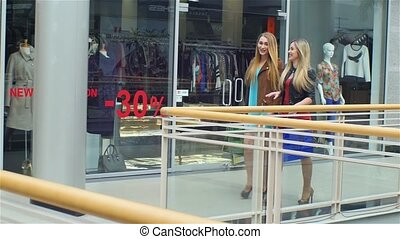 Girls go along and shop talk at the same time, shopping,...