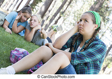 Girls gossiping - Two Young Girls Gossiping about another...