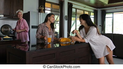 Girls Group Talking Drinking Juice Cooking Breakfast In...