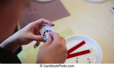 Girl's hand sews beautiful brooch. Needlework