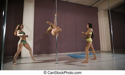 Girls having fun at a pole fitness class