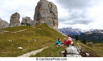 girls hikers resting near of Cinque Torri towers