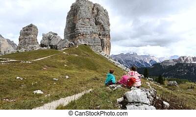 girls hikers resting near of Cinque Torri towers