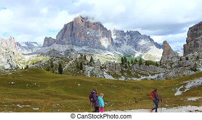 girls hikers walking near of Cinque Torri towers