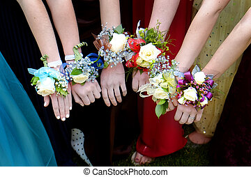 Girls Holding Arms Out with Corsage Flowers for Prom - Girls...