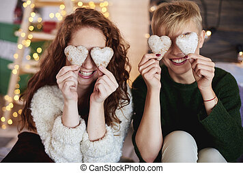 Girls holding heart shaped gingerbread cookies
